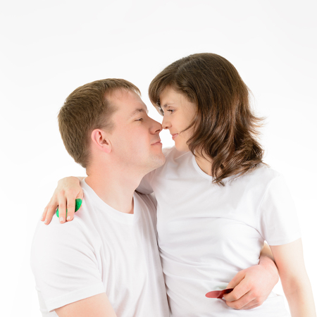 tenderly: Love couple tenderly embracing on a white background