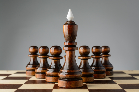 pawns: Black king and pawns on the chessboard
