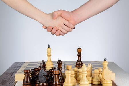 pawn adult: Male and female hand over a chess table Stock Photo