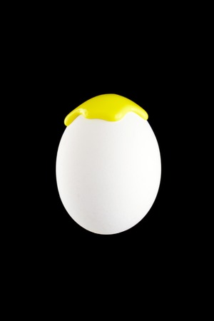 drench: White egg drenched colors on a black background
