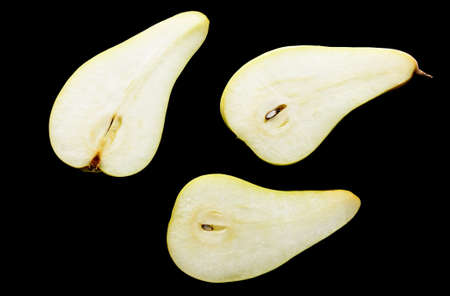 sweet segments: Slices of green pears on a black background