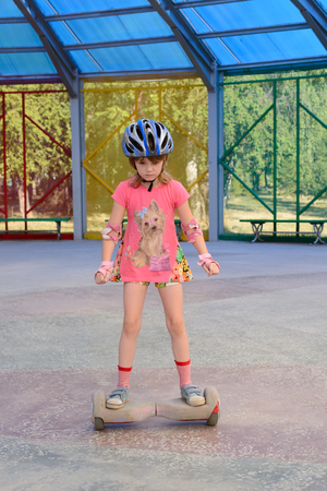Girl riding on the hoverboard in the park