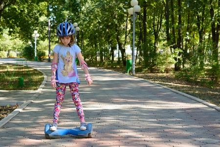 Girl riding on the hoverboard in the park Banco de Imagens - 61577824