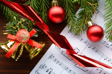 Christmas decorations and fir branch lying on notes sheet Banco de Imagens - 65971942