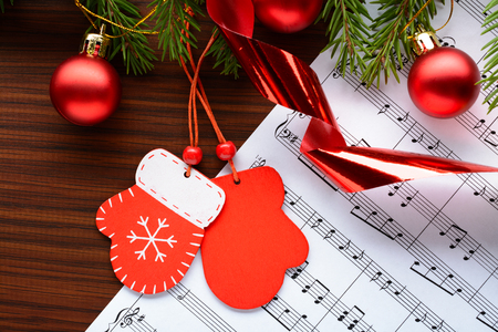 Christmas decorations and fir branch lying on notes sheet Banco de Imagens - 65972032