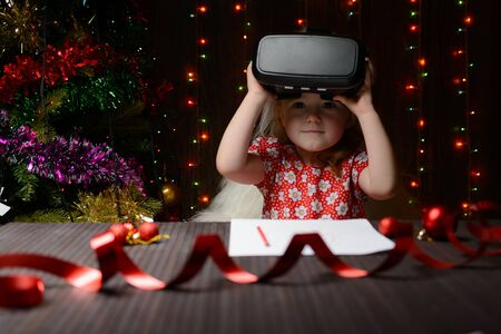 received: The girl received a Christmas present of virtual reality glasses