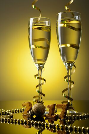 Two wine glasses with champagne and New Year decorations