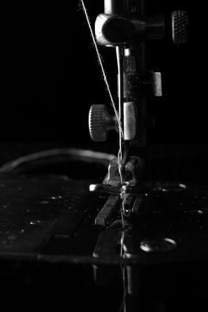Retro elements of the sewing machine on a black background closeup Stock Photo