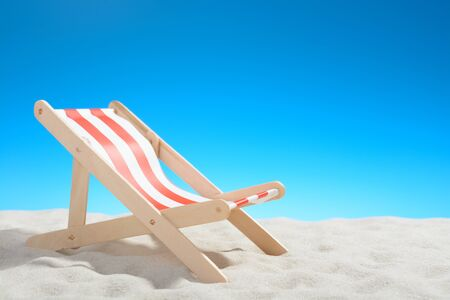 beachfront: Deckchair at the beach on background of blue sky Stock Photo