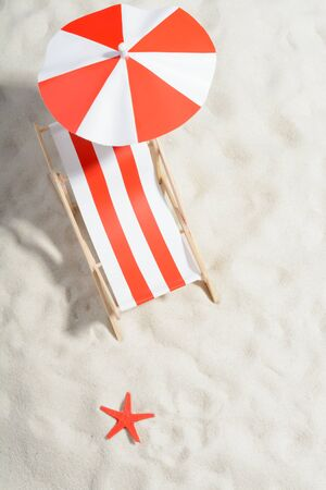 beachfront: Red and white sunbed on the beach: top view