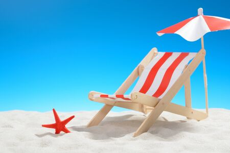 Deckchair at the beach on background of blue sky Stock Photo