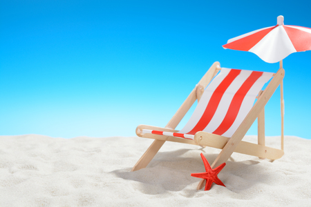 Deckchair at the beach on background of blue sky Reklamní fotografie