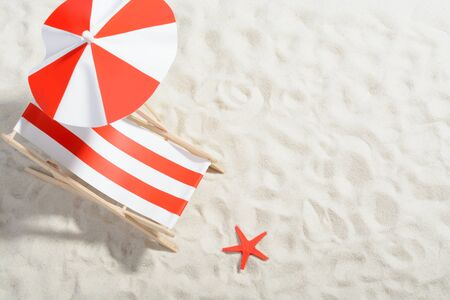 longue: Red and white deckchair on the beach: top view
