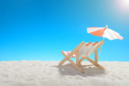 Deckchair on the beach on background of blue sky Stock Photo