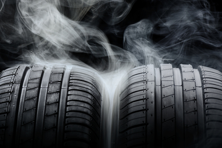Car tires and smoke on black background Stock Photo - 76043876