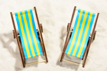 Two sunbeds on the beach: top view Stock Photo