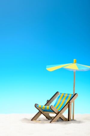 Sunbed at the beach on background of blue sky