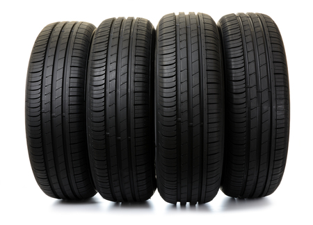 Car tires on white background
