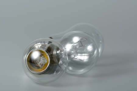 Three incandescent bulbs on grey background