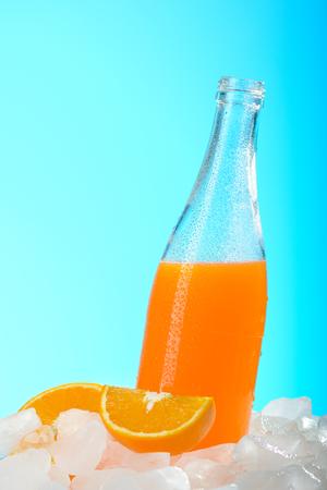 The bottle of orange juice on ice Stock Photo
