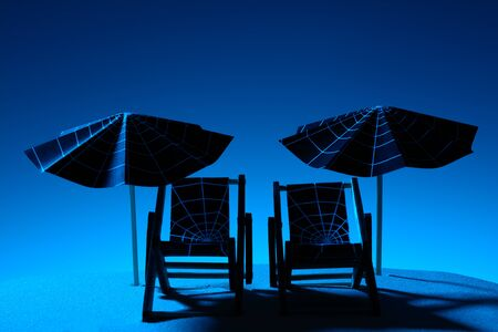 Two beach chairs and umbrellas with web pattern in moonlight on beach