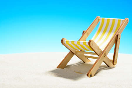 Sun lounger on the sandy beach and sky with copy space