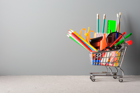 Small shopping cart with various school supplies
