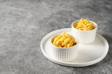National food cuisine of the Middle East. Sweet dessert CHAK-CHAK in two bowls on a gray concrete background. Copy space.