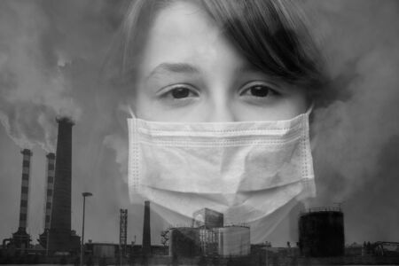 Double exposure, black and white image. Caucasian Teenager girl in a protective mask and industrial exhaust pipes with smoke. Horizontal orientation.