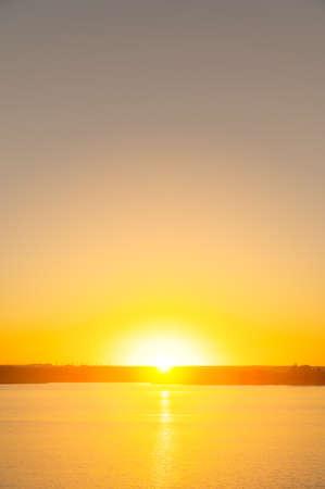 Summer sunset over the lake. Minimalistic landscape