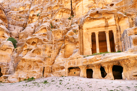 colonnaded: Scenic View Ancient Rock-Cut Colonnaded Triclinium and Staircase Ruins in Little Petra, Jordan Stock Photo