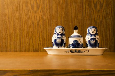 nested: Nested dolls Gzhel on a wooden background Stock Photo