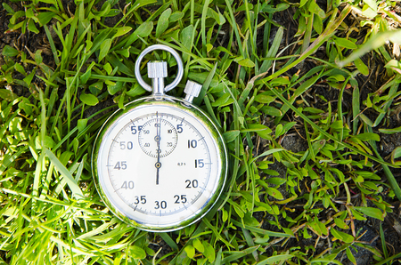 stop watch: Sports stop watch against a green grass