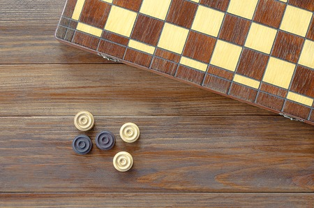 checkers: Table game checkers draughts on wooden background Stock Photo