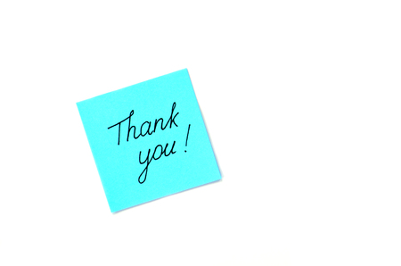 politely: Writing text Thank you on blue paper sticker isolated on a white background