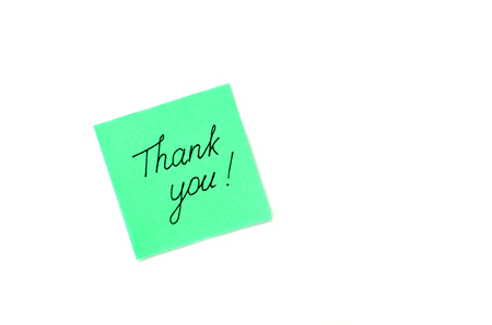 politely: Writing Thank you on green paper sticker isolated on a white background Stock Photo