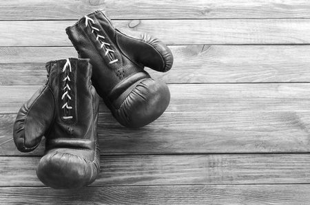 knockdown: Boxing gloves on a wooden board background Stock Photo