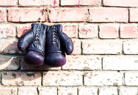 knockdown: Boxing gloves on a wall white red color