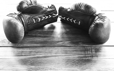 knockdown: Sport boxing gloves on a wooden board background