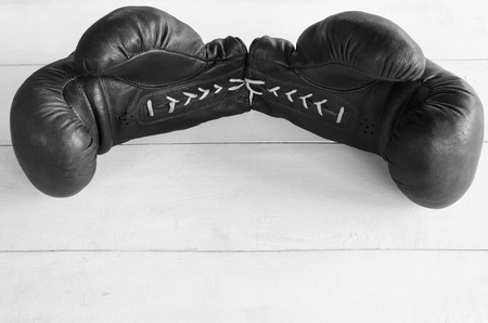 knockdown: Boxing gloves on a white wooden background
