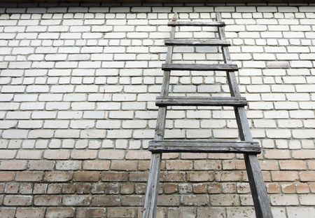 raiser: Ladder staircase step up on wall background Stock Photo