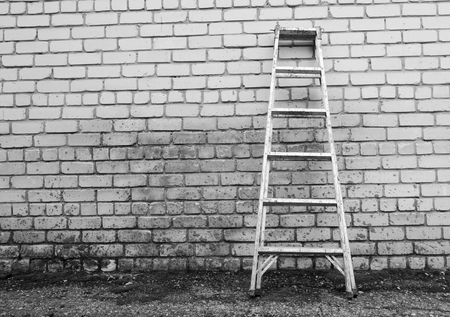 raiser: Metal ladder on a spotty wall backgrounbd