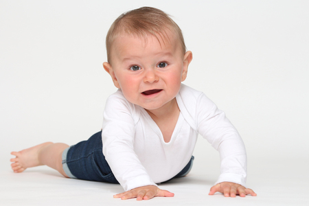 Happy baby on white background Banque d'images - 87926667