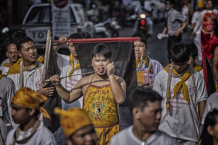 practiced: NAKHONRACHASIMA, THAILAND : A Taoist devotee participates in the Phuket Vegetarian Festival The festival ritual mortification is practiced to appease the Gods.