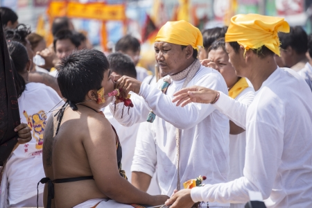 appease: NAKHONRACHASIMA, THAILAND : A Taoist devotee participates in the Phuket Vegetarian Festival The festival ritual mortification is practiced to appease the Gods.