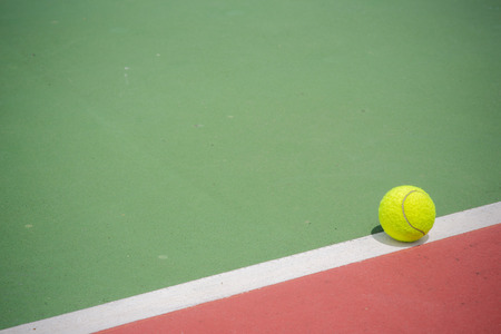 Tennis Ball on the Court photo