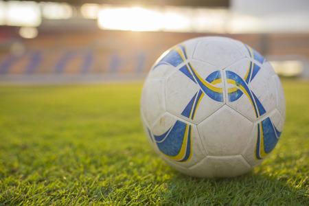 Old Soccer or Football in the sunset stadium Background Standard-Bild
