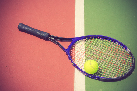 avocation: tennis racket and balls on the tennis court vintage color