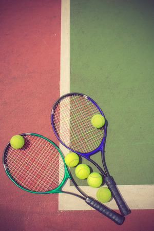 racket: tennis racket and balls on the tennis court vintage color