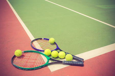 tennis court: tennis racket and balls on the tennis court vintage color